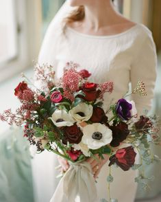 I like this idea with less red and pulling in the magnolia leaves wedding colors 52 Gorgeous Winter Wedding Bouquets Winter Wedding Flowers, Flower Bouquet Wedding, Purple Wedding, Flower Bouquets, Ranunculus Wedding, Anemone Bouquet, Purple Bouquets, Blush Bouquet, Anemone Flower
