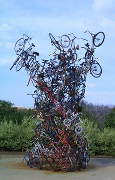 Bicycle Tornado  14' x 14' x 20' Athens, Georgia 2001  One hundred and sixty recycled bicycles welded together form this sculpture. Each bicycle was bent into a curve approximately 4 ft. in radius. Some were curved to the left and some to the right. This curving allowed the bicycles to be easily stacked and gives the sculpture structural integrity.
