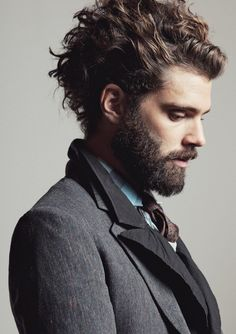 Hot bearded man, profile in suit.