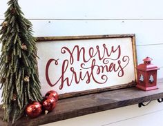Merry Christmas Wood Sign Christmas Sign  It is 13 1/2 x 25 1/2 with its frame which is stained a dark walnut It hangs from a framed ledge on the back so no hanging hardware is needed  It is white with red letters CUSTOM COLORS AVAILABLE  Our signs are rustic, hand painted and distressed so again there will be imperfections and no 2 will be alike
