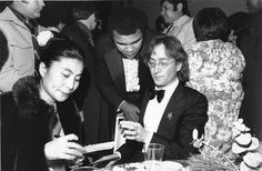 John Lennon and his wife, Yoko Ono, left, are shown with heavyweight boxer Muhammad Ali, center, at the Kennedy Center for the Performing Arts in Washington, D.C., on Jan. 20, 1977. They are at the gala honoring President-elect Jimmy Carter on the eve of his inauguration. (AP Photo)