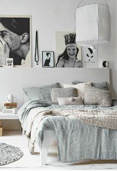 build a wall headboard so you can lean pictures on it like a shelf