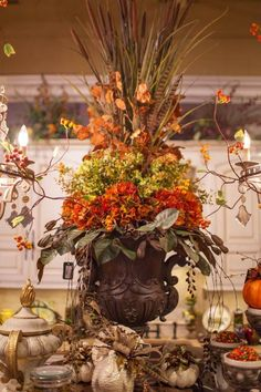 Create a statement with a handcrafted fall silk flower arrangement. Each one is one-of-a-kind so it's as unique as you!