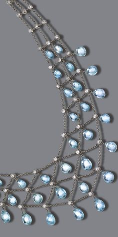 PLATINUM, AQUAMARINE BRIOLETTE AND DIAMOND NECKLACE The delicate lattice chain supporting 36 briolette aquamarine drops and set with 79 small old European-cut diamonds weighing approximately 4.00 carats, length 17 inches.