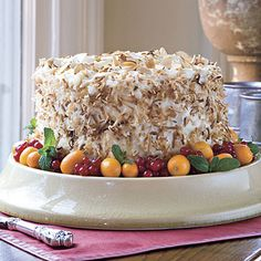 Coconut-Almond Cream Cake | This decadent cake is deliciously rich as well as moist. For a colorful presentation, garnish with kumquats, currants, and fresh mint sprigs. | #Thanksgiving Dessert Recipes