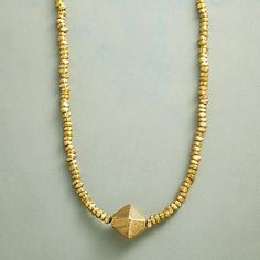 """PARTNERS NECKLACE Item No. 74043$178.00 Slip this handmade brass and bronze necklace on to rock a chic, distinctive look with ease.  Brass beads and a bronze nugget collaborate in our exclusive handmade necklace. Oxidized brass chain slips over the head. USA. Approx. 34""""L."""