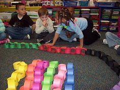 What if each student built a bit of the chain themselves and then you added all the bits together to create a 100 link long chain? How long might that chain be when it is finished? Great group/estimation project!