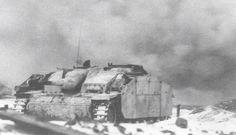 StuG iii in combat near a Russian village