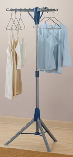 Tripod clothes drying rack // love this clever space-saving design #product_design #organization