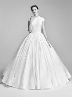 Italian flocked sequin gown draws all attention to its voluminous statement skirt petite tailored sleeves and a crystallised neckline with a matching waistband ball gown wedding dress #wedding #weddingdress #weddinggown