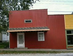 The restoration of the The Strand Theater, red metal siding to cover the original old wooden siding.