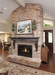 Double-sided fireplace with mantel create warmth from all views