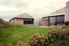 A Moelven prefabricated house turned modern cluster court | Inspirationist