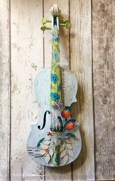 Altered violin using #paperartsy #fresco paints and crackle glaze and #jofystamps plus a #linbrown stencil #alteredviolin #paintedviolin