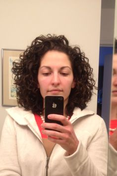 My naturally curly hair, shoulder length. I just apply mousse and then blow dry with a diffuser. - This is a lot like mine looks if I do what she said...