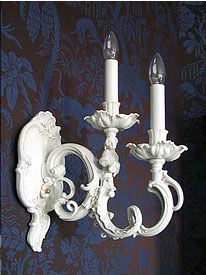 Porcelain Rococo wall sconce by Nymphenburg.