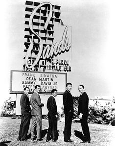 """the granddaddies of style: the Rat Pack. Frank Sinatra, Dean Martin, Sammy Davis Jr., Peter Lawford and Joey Bishop pose outside the Sands Hotel and Casino during production of 1960's """"Ocean's 11."""""""