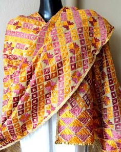 Look graceful in the unique and sober color combination of this hand embroidered phulkari work dupatta. It has been heavily embroidered in the traditional geometric pattern of phulkari, with thread and sequins. It can even be stitched into a gorgeous kurta - See more at: http://giftpiper.com/Phulkari-Bagh-Work-Dupatta-Mauve-Yellow-id-331307.html#sthash.GmzXtr3Q.dpuf