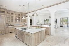 Contemporary Kitchen with limestone tile floors, Columns, Maryland Kitchen Cabinets 613 Hickory Base 612S, Crown molding