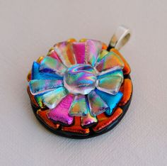 Fused Glass Dichroic Pendant by delphiglass.com. Use Friendly Plastic: cut pieces; make 3 layers of f.p.