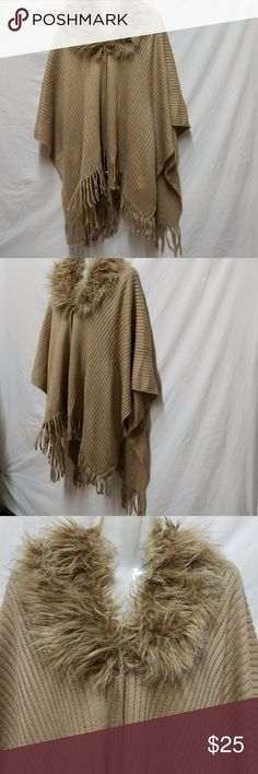 Attention Sweater Plus Size OSFM Cape Attention Cape. One size fits most, faux fur collar, tan color, knitted, snaps at neckline. This lightweight knit poncho/cape keeps you surprising warm and the color will go with just about anything in your wardrobe. Attention Jackets & Coats Capes