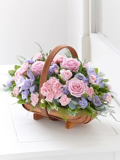 Mixed Basket - Pink and Lilac.A traditional Two Tone Trug Basket filled with roses, veronica, statice and scented freesias in pinks and lilacs. Picture shows large size arrangement. Silk Flowers, Spring Flowers, Beautiful Flowers, Basket Flower Arrangements, Floral Arrangements, Online Flower Shop, Arte Floral, Flower Boxes, Basket Of Flowers