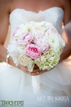Roses, hydrangea and just a touch of bling make the perfect classic with a touch of color wedding bouquet. Photo by Kriea Arie #trochtas #wedding #bride #ceremony #flowers