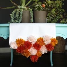 Full tutorial to make this colorful and easy pom pom table runner