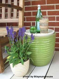 made a little side table with a large planter and a terra cotta saucer that they sealed, painted and used as the top.