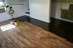 refinishing hardwood floors to get a dark walnut finish.