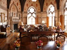 Lufkin apartment:  The main living space. Once the chapel of the New York Cancer Hospital, the living room has a 38-foot vaulted ceiling with Gothic arched windows looking out to Central Park. The original bricks walls were recovered in plaster and painted with a stencil reminiscent of an English abbey.