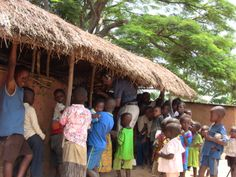 Next step up in classrooms - crumbling mud walls and thatched roofs