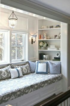 Comfy little book nook. Pretty blue and gray mixture of patterns.