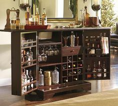 A home bar is one of the most fun places in the house, and it's a great area to add a pop of color—whether in the cabinetry, stools, walls or art. Check out 33 custom home bar design ideas. All styles, sizes and materials. These are awesome. Mini Bars, Drinks Cabinet, Liquor Cabinet, Alcohol Cabinet, Modern Outdoor Furniture, Man Room, Diy Décoration, Bar Furniture, Creative Home