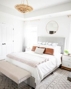 All white bedroom design has layers of texture and leather throw pillows for pops of color. The vintage style gold ceiling pendant is the showstopper in the room. Dream Bedroom, Home Bedroom, Modern Bedroom, Bedroom Decor, Master Bedroom, Airy Bedroom, Contemporary Bedroom, Guest Bedrooms, Bedroom Inspo