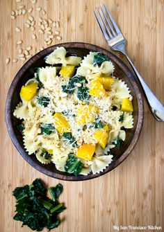 A recipe for yellow beet pasta made with farfalle noodles, kale, pine nuts, and a light creamy alfredo sauce.