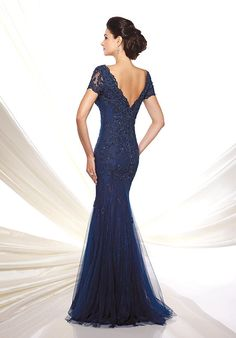 Lace and tulle slim trumpet gown with lace illusion short sleeves, front and back scalloped V-necklines, dropped waist, inset sweep train.