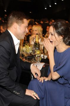 Angelina Jolie whispering to Brad Pitt at the 2009 Screen Actors Guild awards. See 19 more rarely-seen portraits of the actress over the past four decades.