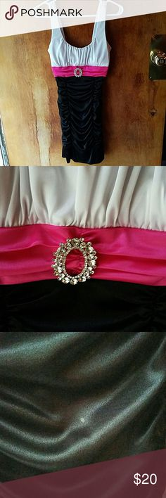 Formal Homecoming Dress Size Small. Top is white, with a pink middle and bottom is black. Silver pin is attached to dress in the middle and is removable.   Wore to Homecoming, and got a small chocolate stain on dress. See picture. Spot is very small and is hardly noticeable.   Dress has been dry cleaned and is ready to be sent to you! Deb Dresses Prom