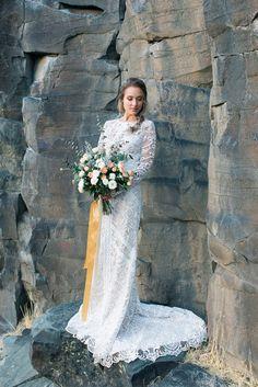 Organic free flowing wedding bouquet. Bride in a Tara Lauren wedding gown.