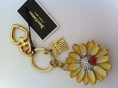 We're loving this new Juicy Couture Daisy Keyfob for Spring in our Store! This is the perfect accessory to brighten up any outfit when you carry your keys! Find this item by visiting www.theshoppingbagstore.com