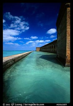 Fort Jefferson moat and massive brick wall on a sunny dayl. Dry Tortugas National Park, Florida, USA. by QT Luong