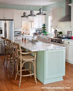 House of Turquoise: Anna Dickinson + White Goat: like the island color reflected on wall.  Also the mix of beadboard and shaker cabs