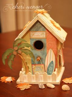 I started with a naked birdhouse from Joann's and used Glue Arts' Crop & Glue Adhesives along with Inque Boutique's Cabana Paper Pack, Caban. Decorative Bird Houses, Bird Houses Painted, Bird Houses Diy, Putz Houses, Fairy Houses, Dog Houses, Bird House Plans Free, Dog House Plans, Modern Beach Decor