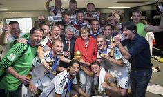 A handout photo released on July 13, 2014 by the Bundesregierung, the German government press office, shows German Chancellor Angela Merkel (C) and German President Joachim Gauck (CenterL)celebrating with German players and coach Joachim Loew after Germany won the 2014 FIFA World Cup final football match between Germany and Argentina at the Maracana Stadium in Rio de Janeiro, Brazil.