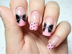 Black and pink bow nail art.