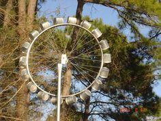 Using bicycle rim, add sausage cans around edge, and voila — a windmill! Using bicycle rim, add sausage cans around edge, and voila — a windmill! Bicycle Rims, Bicycle Wheel, Bicycle Art, Bike Wheels, Wind Sculptures, Sculpture Art, Metal Yard Art, Metal Art, Glass Garden