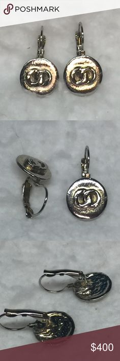 Vintage Chanel Drop CoCo with CC Logo Vintage Chanel, round disk which are about the size of a dime, CC raised Logo, lever hinged. In very good condition. Possible some wear but I am not aware of. CHANEL Jewelry Earrings