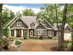 Love everything about the exterior of this house:  Ranch House Plan with 4941 Square Feet and 4 Bedrooms(s) from Dream Home Source | House Plan Code DHSW75583