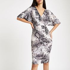ae5016064e4 Slinky jersey fabric Snake print Wrap front Short sleeve Tie back Midi  length Our model wears a UK 8 and is tall
